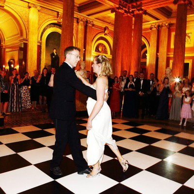Couple dance in the main reception of the Reform Club.