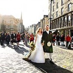 Scottish wedding procession on Royal Mile.